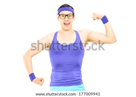 Nerdy man in sportswear showing bicep isolated on white background - stock photo