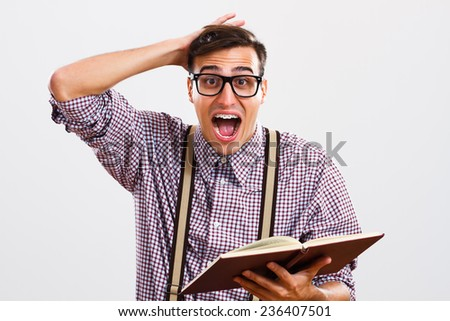 Nerdy man is in panic because he doesn't have too much time for learning.Nerdy man in panic - stock photo