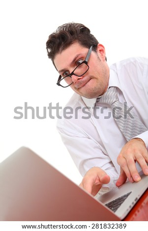 nerdy man with computer on white background - stock photo