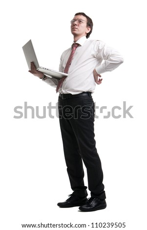 Nerdy manager holding his laptop - stock photo