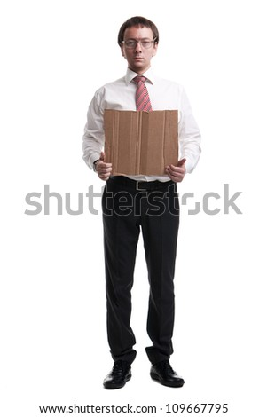Nerdy manager showing blank cardboard - stock photo
