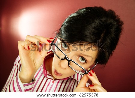 Nerdy office woman over bordeaux background looking ecstatic - stock photo