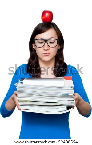 nerdy young female with books and apple placed on her head isolated - stock photo
