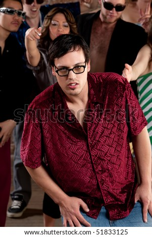 Nerdy young man stumbling at a 1970s Disco Music Party - stock photo