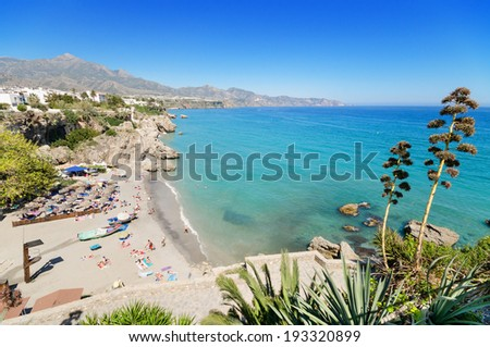 Nerja beach, famous touristic town in costa del sol, Malaga, Andalusia, Spain. - stock photo