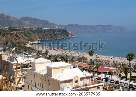NERJA, MAY 11: beautiful Burriana beach; on May 11, 2014 Nerja, Spain. Nerja is famous resort on Costa del Sol situated 50 km from Malaga. - stock photo