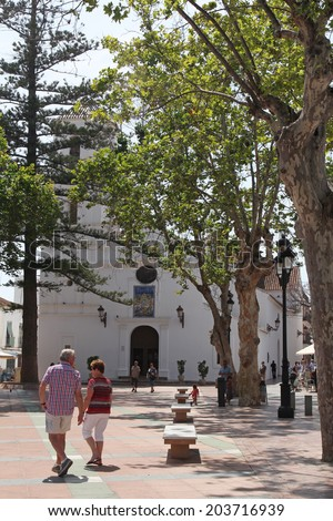 NERJA, MAY 10: The Church of El Salvador and Plaza Balcon de Europa; on May 10, 2014 Nerja, Spain. Nerja is famous resort on Costa del Sol situated 50 km from Malaga.  - stock photo