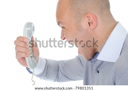 Nervous businessman screaming on the phone. Isolated on white background