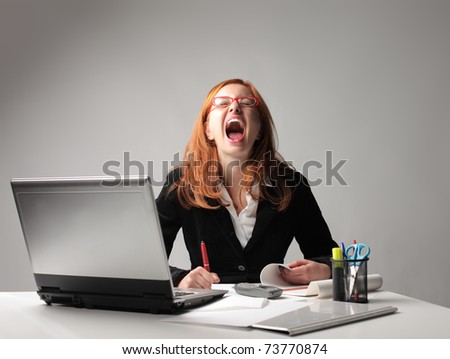 Nervous businesswoman at the office - stock photo
