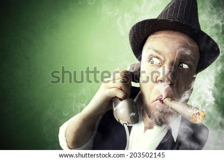Nervous Investigator having an important phone call while smoking - stock photo