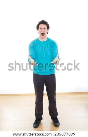 Nervous man in stress with cramped hands yelling, Young casual business man with frustration expressing crisis under pressure - stock photo