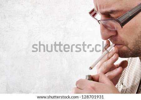 Nervous man lighting a cigarette