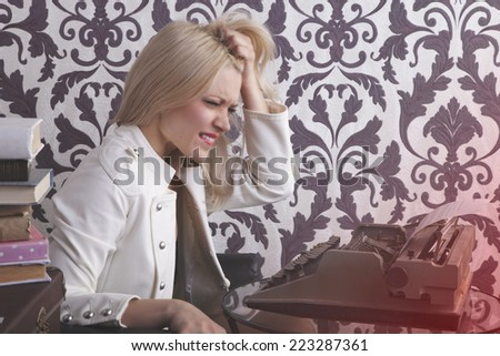 Nervous woman  book writer touching her  hair-stress concept. Retro style photo - stock photo