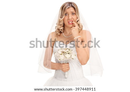 Nervous young bride biting her nails and looking at the camera isolated on white background - stock photo