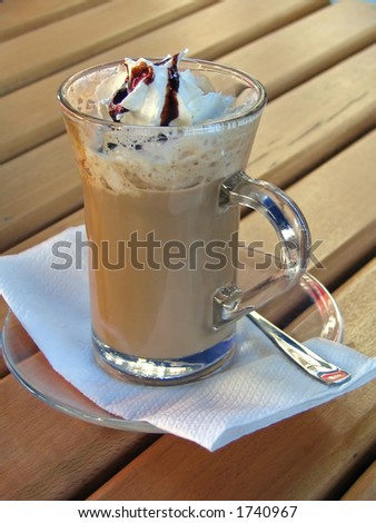 nescafe drink served on wooden bar table - stock photo