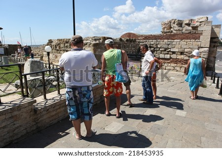 NESEBAR, BULGARIA - AUGUST 29: People visit Old Town on August 29, 2014 in Nesebar, Bulgaria. Nesebar in 1956 was declared as museum city, archaeological and architectural reservation by UNESCO.