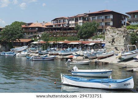 Nesebar, Bulgaria - July 01, 2015: View of the harbor of the old town of Nessebar with fishing boats in the foreground, Black sea coast, Bulgaria.