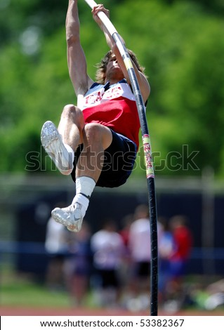 NESHAMINY, PA - MAY 8: A Central Bucks East pole vaulter rises towards the bar during the Neshaminy Invitational Meet on May 8, 2010 in Neshaminy, PA. - stock photo