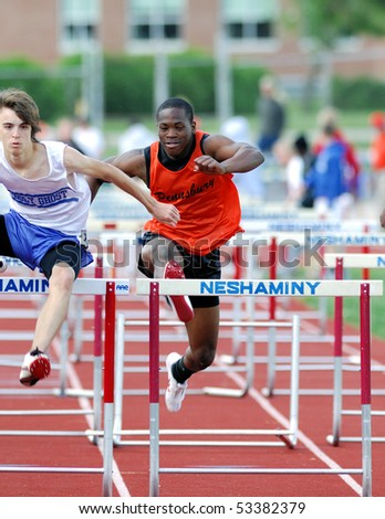 NESHAMINY PA - MAY 8: Two hurdlers head towards the finish line during the Neshminy Invitational Meet on May 8, 2010 in Neshaminy, PA - stock photo