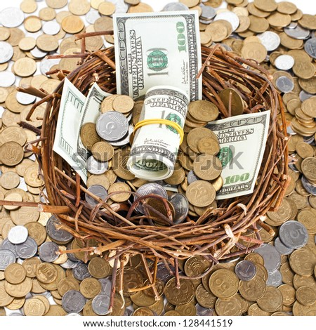 Nest egg overflowing with money - stock photo