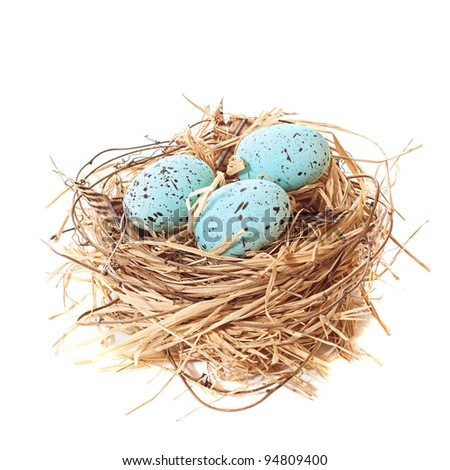 Nest of brightly coloured Easter eggs on a white background - stock photo