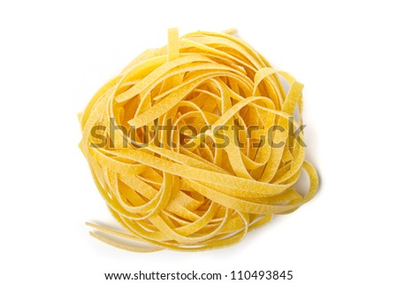 Nest of noodles with eggs - stock photo