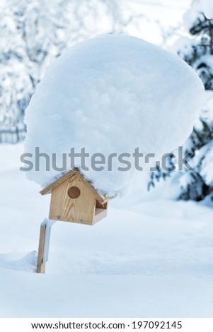 Nesting box covered by snow, Kiruna, Lapland, Sweden - stock photo
