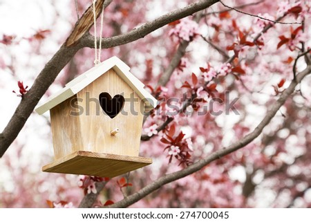 Nesting box hanging on the tree - stock photo