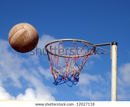 Net Ball just before hitting the rim of the hoop - stock photo