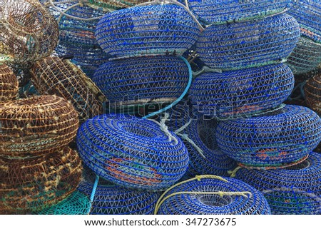 Net cages for catching seafood on the pier in Porto, Portugal - stock photo