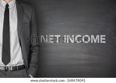 Net income text on black blackboard with businessman - stock photo