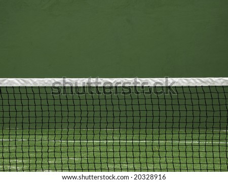Net of tennis court on green wall background. - stock photo