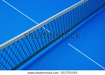 net on a blue pingpong table - stock photo