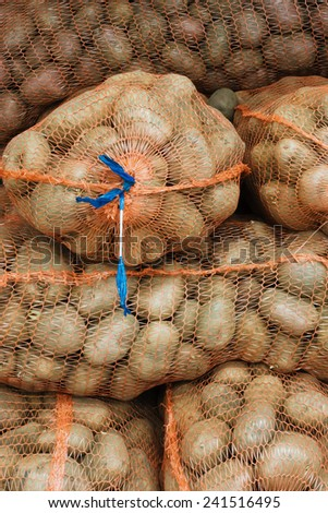 Net sacks with potatoes in the food store  - stock photo