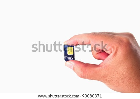 Net Sim card In a hand isolated on white background - stock photo