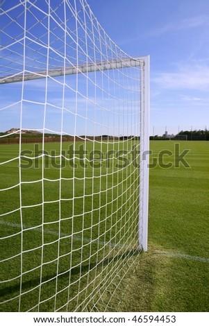Net soccer goal football green grass field sunny day outdoors - stock photo