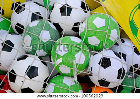 net with assorted soccer balls - stock photo