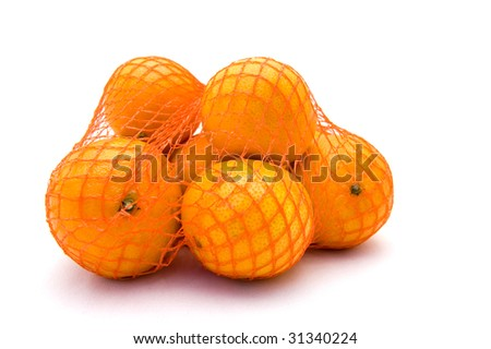 Net with fresh mandarines on a white background - stock photo