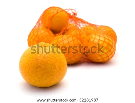 Net with fresh mandarins with one lying in the front - stock photo