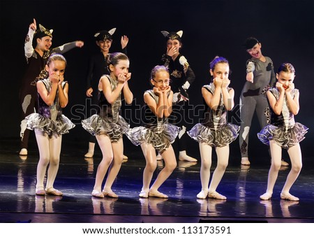 NETANIA, ISRAEL - JULY 12: Unidentified students perform in the final concert of the School of Ballet on July 12, 2012 in Netania, Israel. Concert at the performing arts center of Netania. - stock photo