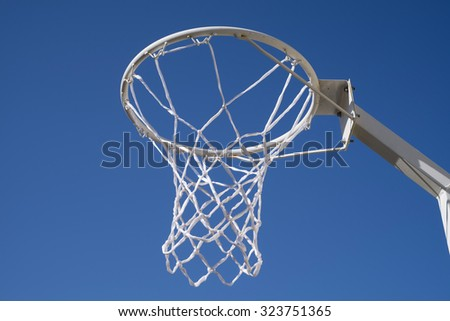 Netball ring with blue sky - stock photo