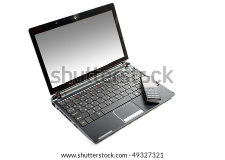 Netbook and mobile phone isolated on the white background. - stock photo