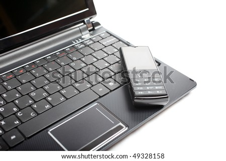 Netbook and mobile phone isolated on the white background.