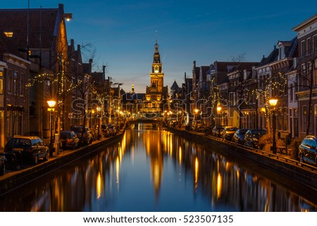 Netherlands Alkmaar 25 November 2016, City center of Alkmaar Holland a canal and the tower of the Waag in the city of Alkmaar, The Netherlands.