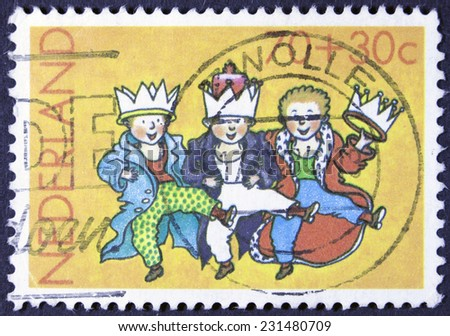 NETHERLANDS - CIRCA 1965: A stamp printed in Netherlands  children stamp with a drawing of three costumed children, circa 1965 - stock photo