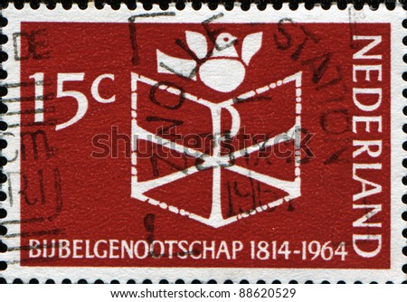 NETHERLANDS - CIRCA 1964: A stamp printed in Netherlands honoring 150th Anniv of Netherlands Bible Society shows Bible and Dove, circa 1964