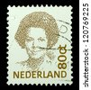 "NETHERLANDS - CIRCA 1991: A stamp printed in Netherlands shows portrait of Beatrix - Queen regnant of Kingdom of the Netherlands without the inscription, from the series ""Queen Beatrix"", circa 1991 - stock photo"