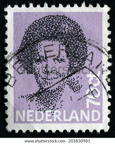 NETHERLANDS - CIRCA 1982: A stamp printed in Netherlands shows portrait of Queen Beatrix regnant of the Kingdom of the Netherlands, circa 1982 - stock photo