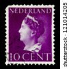 "NETHERLANDS - CIRCA 1940: A stamp printed in Netherlands shows portrait of Queen Wilhelmina - Queen regnant of Netherlands Kingdom (1890 - 1948), w/o inscription, series ""Queen Wilhelmina"", circa 1940 - stock photo"