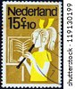 """NETHERLANDS - CIRCA 1964: A stamp printed in the Netherlands from the """"Child Welfare"""" issue shows a girl playing the recorder, circa 1964. - stock photo"""